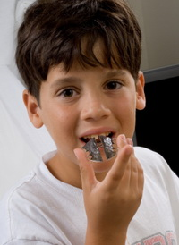 Boy With Retainer - Pediatric and Cosmetic Dentists Keller, and Southlake TX - Donohue & Donohue, DDS