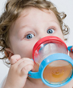 Child with Sippy Cup - Pediatric and Cosmetic Dentists Keller, and Southlake TX - Donohue & Donohue, DDS